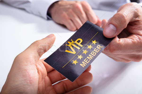 Businessperson Giving VIP Card To His Partner Stock photo © AndreyPopov