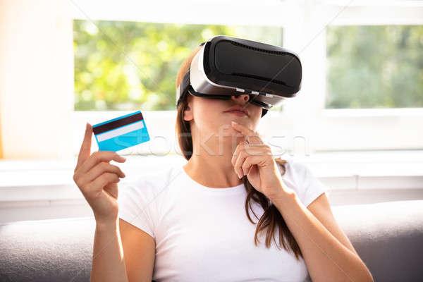 Woman Wearing Virtual Reality Glasses Stock photo © AndreyPopov