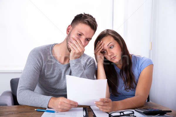 Couple Looking At Invoice Stock photo © AndreyPopov