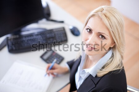 Stock photo: Beautiful businesswoman doing finances