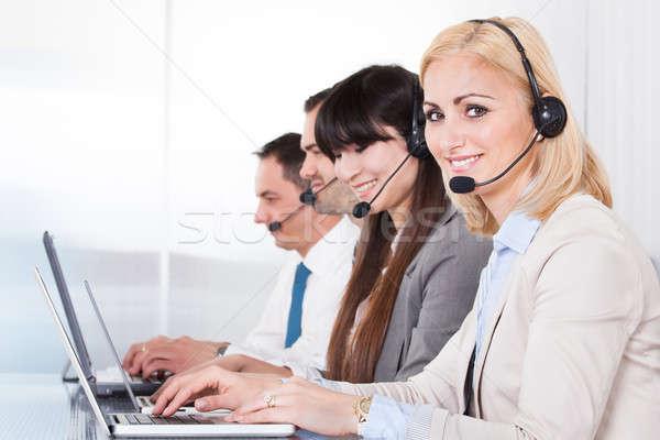 Feliz pessoas de negócios trabalhando laptop escritório computador Foto stock © AndreyPopov