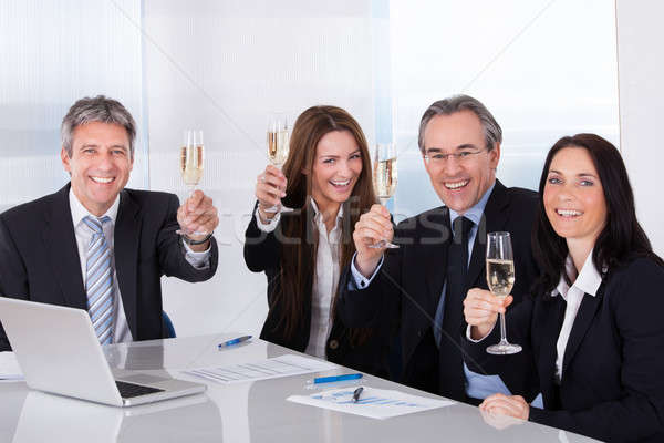 Businesspeople Toasting Champagne Stock photo © AndreyPopov