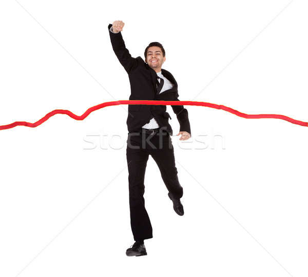 Businessman running through finishing line Stock photo © AndreyPopov