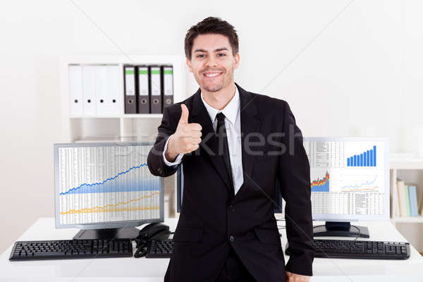 Confident smiling stock broker Stock photo © AndreyPopov