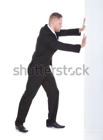 Male Secret Agent Aiming With Gun Stock photo © AndreyPopov