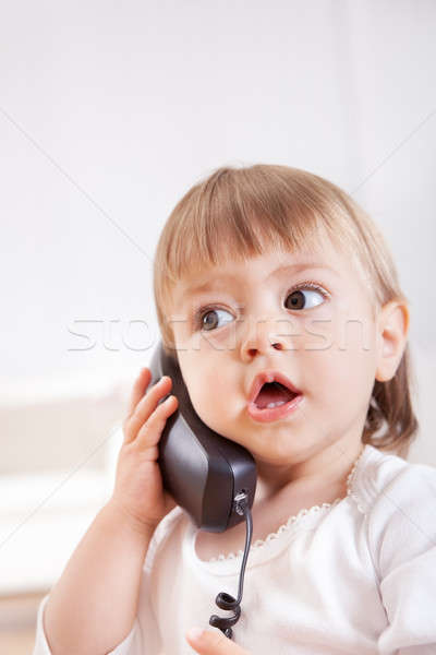 Small girl listening to a phone Stock photo © AndreyPopov