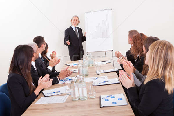Business Team Sitting At Table And Applauding Stock photo © AndreyPopov
