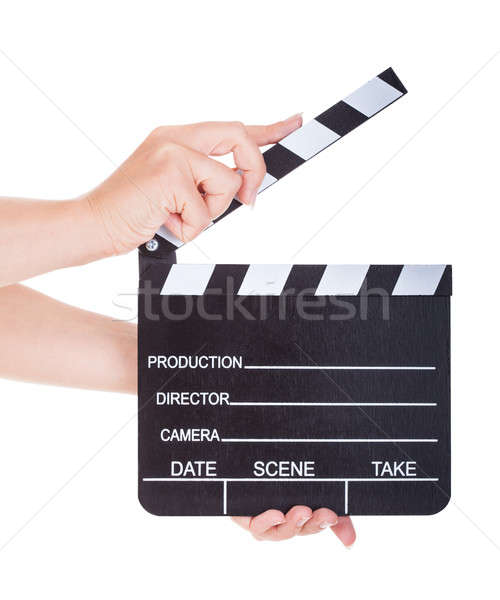 Hand Holding Clapperboard On White Background Stock photo © AndreyPopov