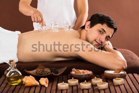 Młoda kobieta relaks leczenie uzdrowiskowe kamień masażu kobieta Zdjęcia stock © AndreyPopov