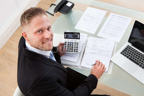 Friendly businessman at work in the office Stock photo © AndreyPopov