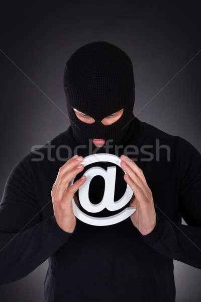 Hacker with an internet domain symbol Stock photo © AndreyPopov