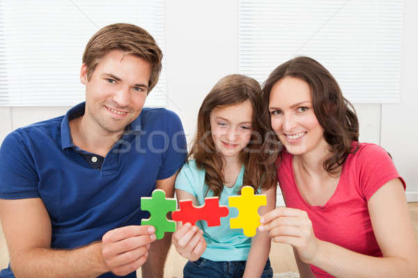 Happy Family Joining Puzzle Pieces Stock photo © AndreyPopov