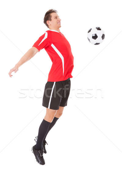 Professional soccer player kicking ball Stock photo © AndreyPopov