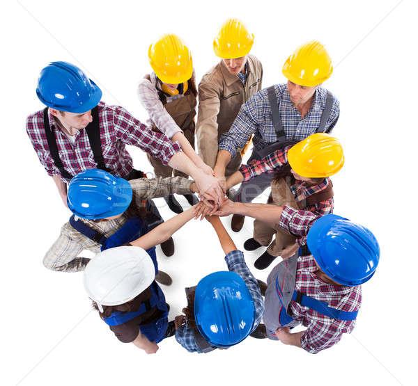 Bouwvakker handen geïsoleerd witte bouw Stockfoto © AndreyPopov