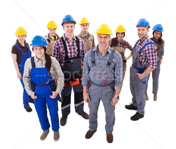 Confident diverse team of workmen and women Stock photo © AndreyPopov