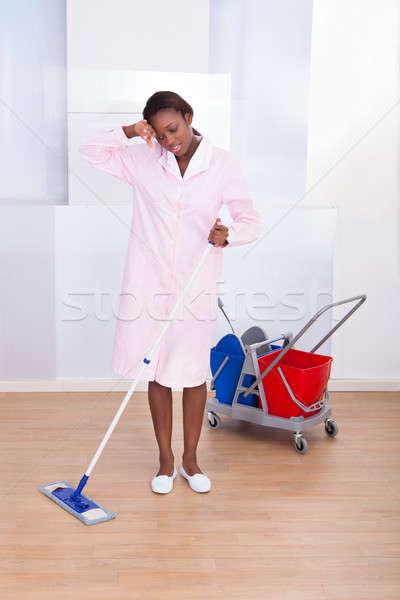 Tired Housekeeper Cleaning Hotel Floor Stock photo © AndreyPopov