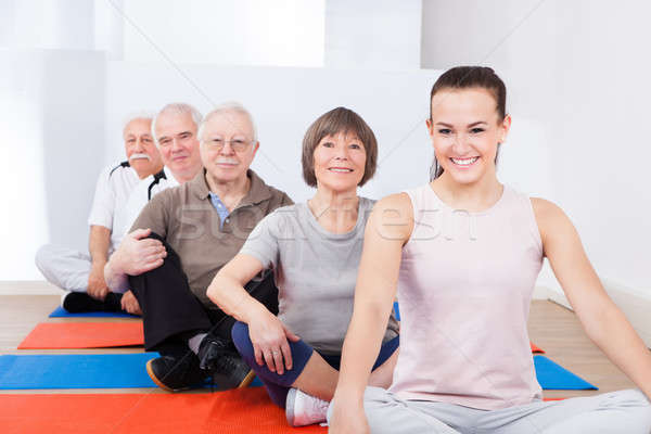 Trainer And Senior Customers Sitting In Yoga Class Stock photo © AndreyPopov