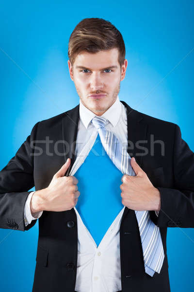 Confident Superhero Businessman Tearing Suit Stock photo © AndreyPopov