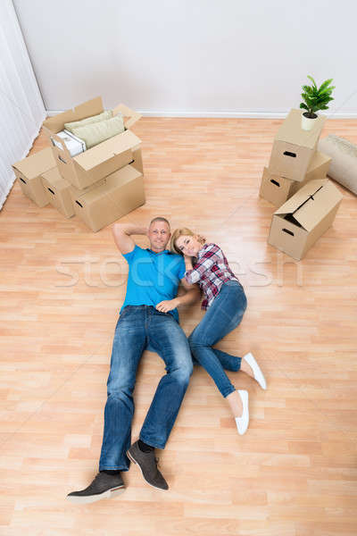 Young Couple Relaxing In New Home Stock photo © AndreyPopov