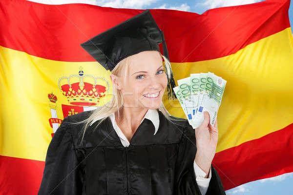 Homme diplômé étudiant argent drapeau espagnol Photo stock © AndreyPopov