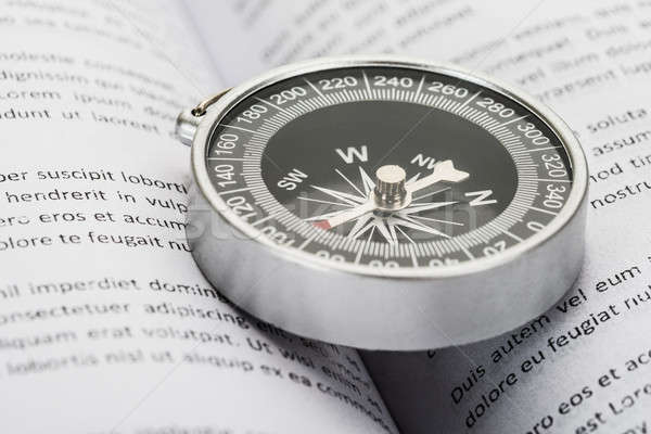 Close-up Of Compass On Book Stock photo © AndreyPopov