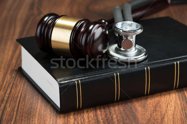 Gavel And Stethoscope On Book Stock photo © AndreyPopov