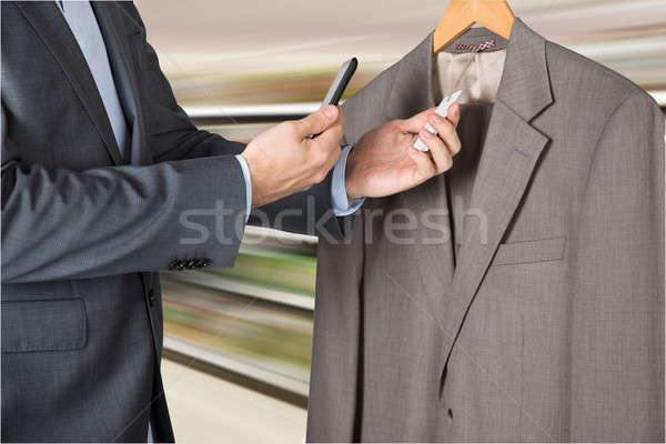 Man Scanning The Price Tag With Mobile Phone Stock photo © AndreyPopov