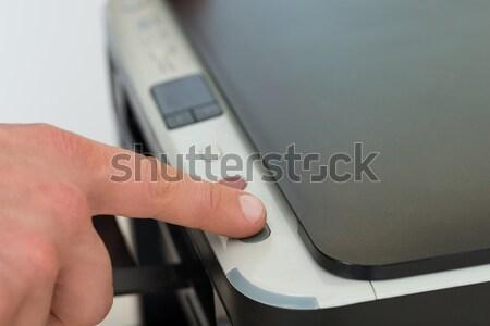 Businessman's Finger Pressing Button Of Photocopy Machine Stock photo © AndreyPopov