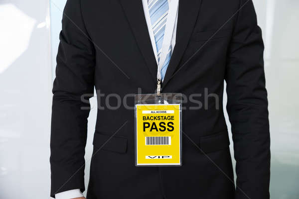 Midsection Of Businessman Wearing Backstage Pass Stock photo © AndreyPopov