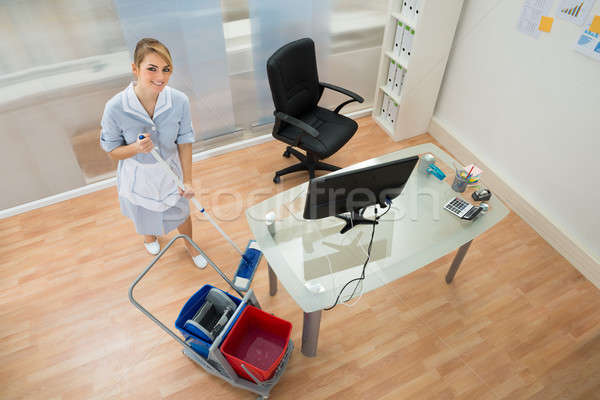 Happy Maid With Mop In Office Stock photo © AndreyPopov