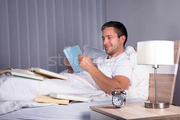 Man Enjoying Reading Book Stock photo © AndreyPopov
