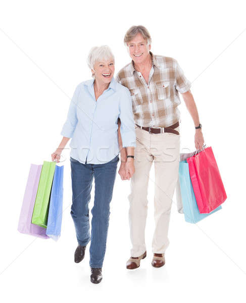 Seniors Couple Walking With Shopping Bag Stock photo © AndreyPopov