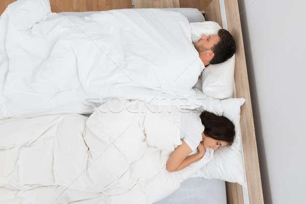 Stock photo: Couple Sleeping On Bed