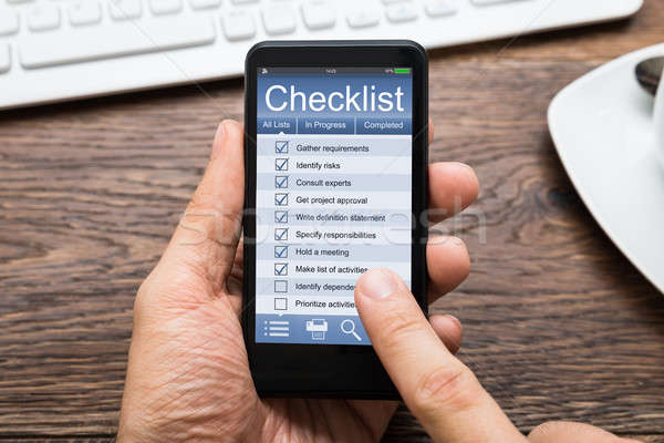 Person Hands Filling Checklist On Mobile Phone Stock photo © AndreyPopov
