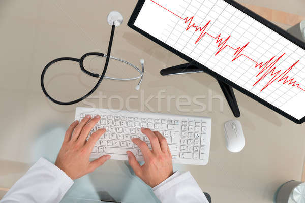 Doctor With Computer Showing Cardiogram Stock photo © AndreyPopov