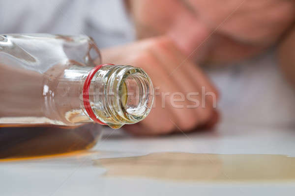 Drunk Man With A Bottle Of Liquor Stock photo © AndreyPopov