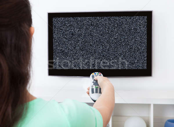 Woman In Front Of Television With No Signal Stock photo © AndreyPopov