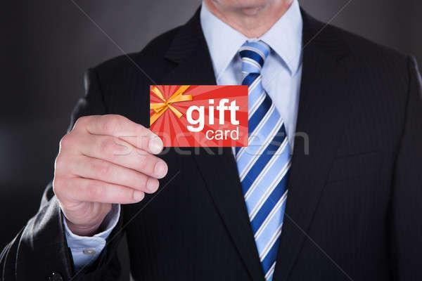 Geschäftsmann halten Geschenkkarte schwarz Business Stock foto © AndreyPopov