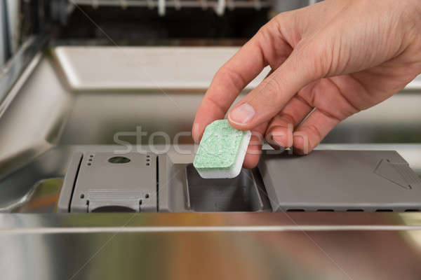 Person Hands Putting Dishwasher Tablet In Dishwasher Box Stock photo © AndreyPopov