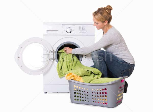 Woman Loading Washing Machine Stock photo © AndreyPopov