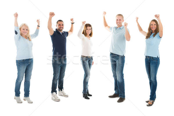 Confident People In Casuals Standing With Arms Raised Stock photo © AndreyPopov