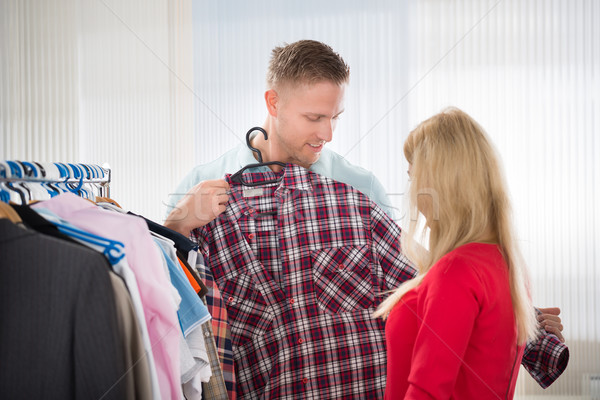 Man Showing Checked Shirt To Woman Stock photo © AndreyPopov
