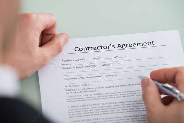 Person Hand Over Contractor's Agreement Form Stock photo © AndreyPopov