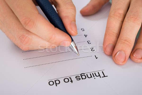 Pessoas mão escrita coisas para fazer a lista Foto stock © AndreyPopov