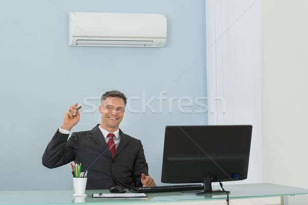 Olgun işadamı klima ofis mutlu oturma Stok fotoğraf © AndreyPopov