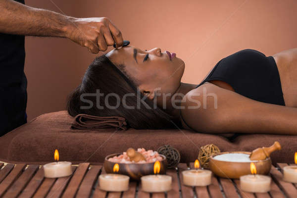 Woman Receiving Hot Stone Massage Stock photo © AndreyPopov
