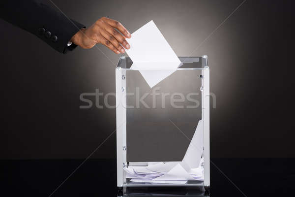 Businessperson Hand Inserting Ballot In Box Stock photo © AndreyPopov