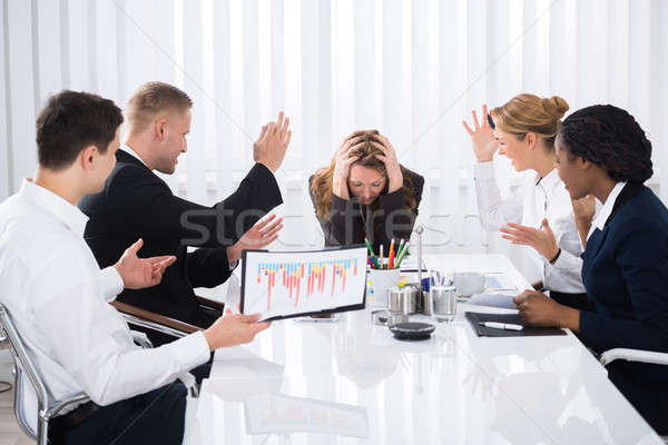 Upset Businesswoman In Meeting Stock photo © AndreyPopov