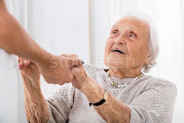 Idős beteg kéz a kézben női orvos boldog Stock fotó © AndreyPopov