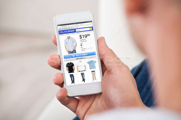 Close-up Of Man Shopping Online On Smartphone Stock photo © AndreyPopov